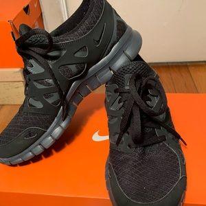 All black Nike sneakers